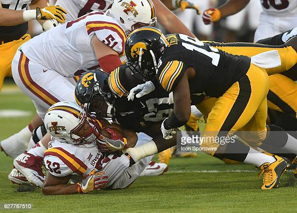 Iowa State running back David Montgomery is surrounded by Hawkeyes during nonconference NCAA football game between the Iowa State Cyclones and the...