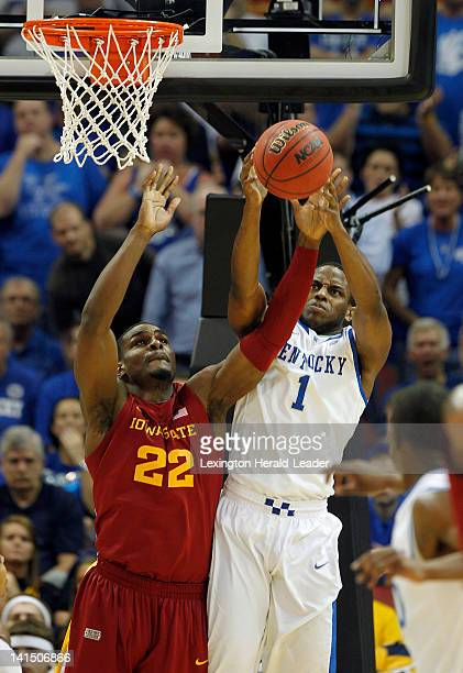 Iowa State's Anthony Booker and Kentucky's Darius Miller battle for a rebound during the first half of a thirdround game in the NCAA Tournament at...