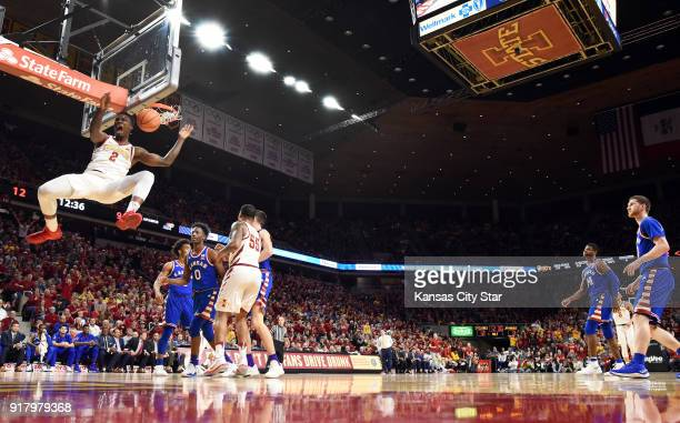 Iowa State's Cameron Lard drives by KU's Devonte' Graham Marcus Garrett and the rest of the Jayhawk defense for a monster dunk during the first half...