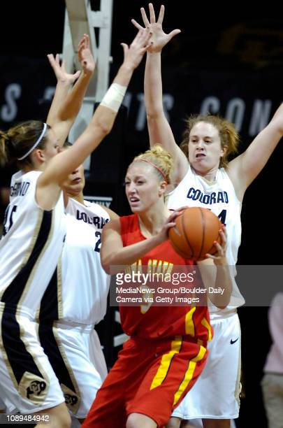 Iowa State's Rachel Pierson runs into the defense of Colorado's Jackie McFarland right Jasmina Ilic and Kara Richards in the first half at Coors...