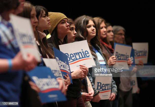 Iowa voters listen as Democratic presidential candidate Sen. Bernie Sanders speaks at the Ames City Auditorium on January 25, 2020 in Ames, Iowa....