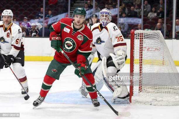 Iowa Wild left wing Kyle Rau looks for a pass in front of Cleveland Monsters goalie Matiss Kivlenieks during the first period of the American Hockey...
