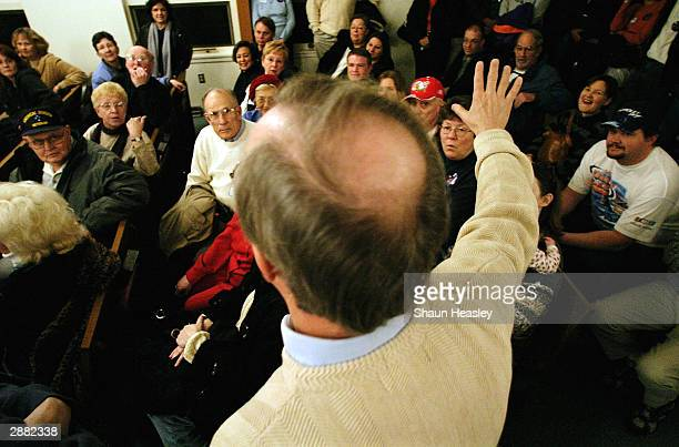 Iowans caucus at St John's United Methodist Church at precinct 87 January 19 2004 in Des Moines Iowa The precinct reported 147 total caucusgoers 64...