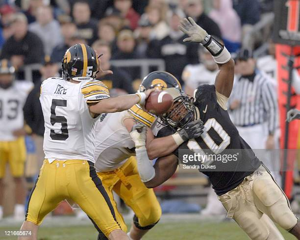 Iowa's Drew Tate stands in the pocket as Purdue's Ray Edwards closes in in Iowa's 3417 win over Purdue at Ross Ade Stadium in West Lafayette Indiana...