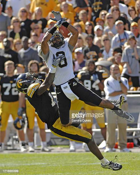 Iowa's Marcus Wilson and Dorien Bryant collide on a pass attempt to Bryant in the second half Iowa defeated Purdue in Kinnick Stadium in Iowa City on...