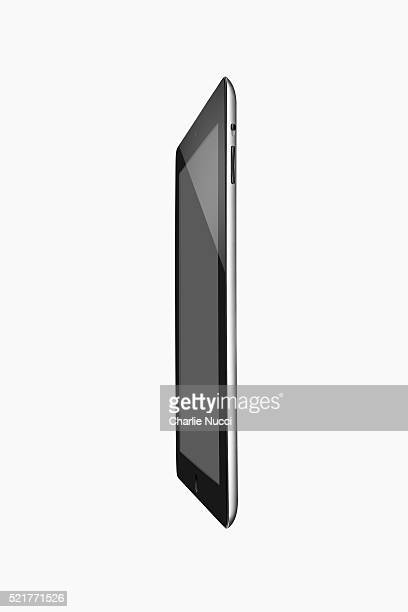 ipad 2 side view - apple computers stock pictures, royalty-free photos & images