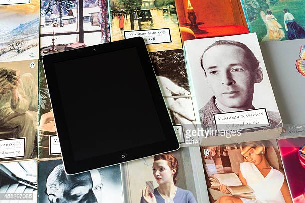 ipad and collection of paperbacks - publisher stock pictures, royalty-free photos & images