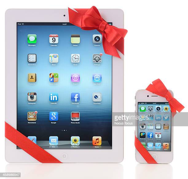 ipad and iphone with red ribbon - gift icon stock photos and pictures