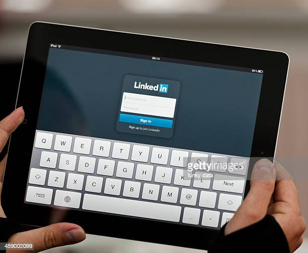 ipad device with linkedin screen - log on stock photos and pictures