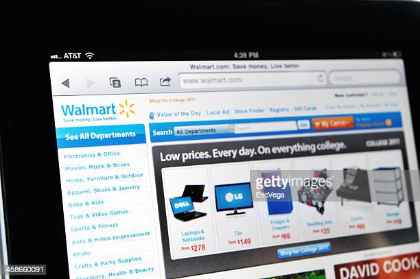 ipad displaying walmart web site - wal mart stock pictures, royalty-free photos & images