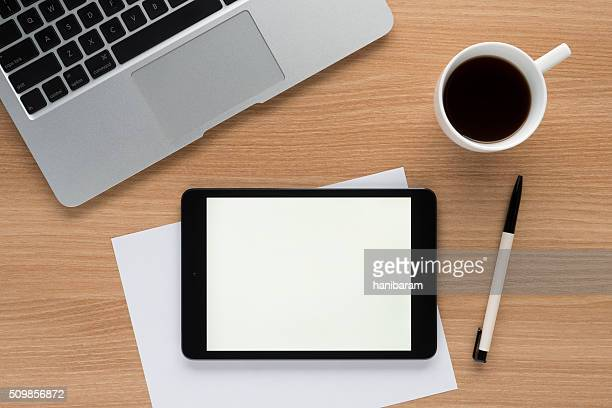 iPad on a desk showing white screen