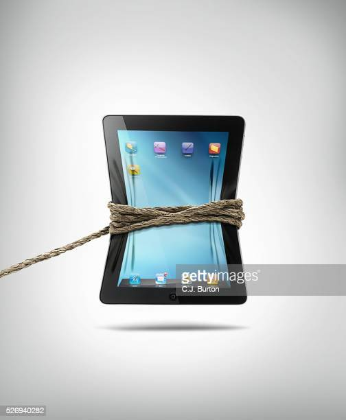 ipad roped - big tech stock pictures, royalty-free photos & images