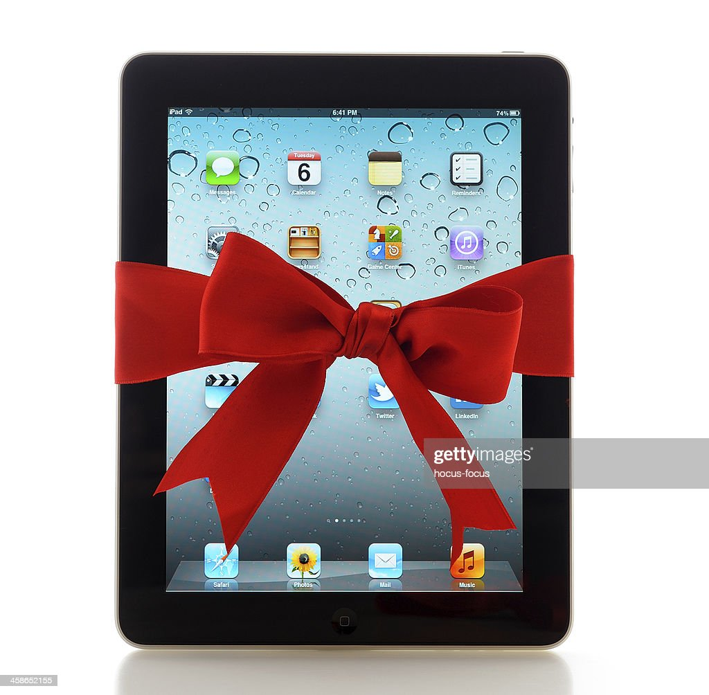 iPad with red ribbon : Stock Photo