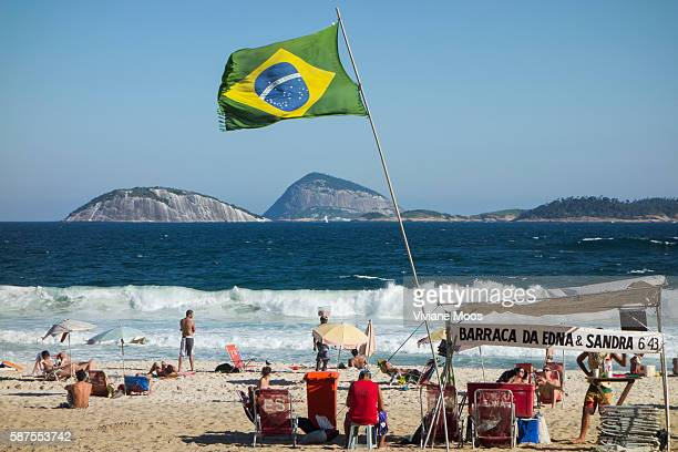 Ipanema beach front and beach scenes Barraca belonging to Edna and Sandra says the banner marking the place to rent beach chairs umbrellas and an...