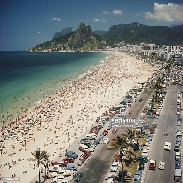 Ipanema Beach in Rio de Janeiro Brazil with the Dois Irmaos mountains in the background circa 1960