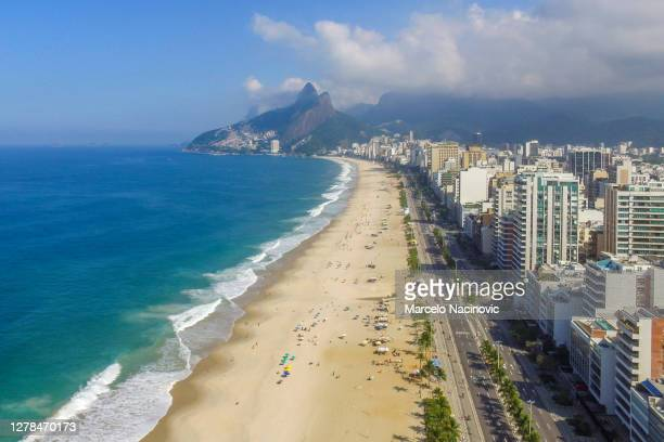 ipanema beach in rio de janeiro - marcelo nacinovic stock pictures, royalty-free photos & images