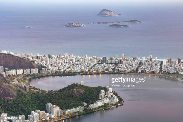 ipanema beach in rio de janeiro seen from corcovado at sunset, brazil - botafogo brazil stock pictures, royalty-free photos & images