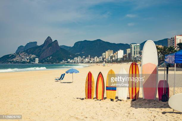ipanema beach  with surfboards and parasol - surfboard stock pictures, royalty-free photos & images