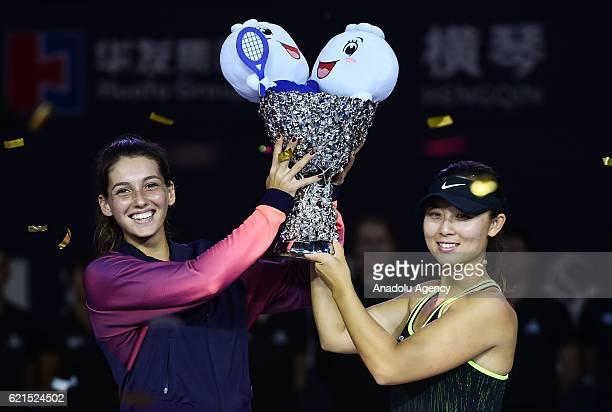 Ipek Soylu of Turkey and Xu Yifan of China pose after the women's doubles final match within the 2016 WTA Elite Trophy Zhuhai at Zhuhai Hengqin...
