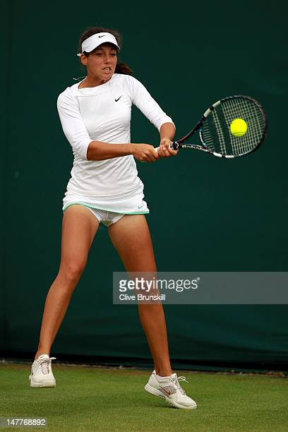 Ipek Soylu of Turkey in action during her Girls' Singles first round match against Maria Ines Deheza of Bolivia on day eight of the Wimbledon Lawn...