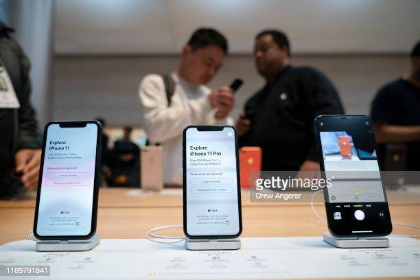 iPhone 11 and iPhone 11 Pro models are displayed as customers shop at Apple's flagship 5th Avenue store on September 20 2019 in New York City Apple's...