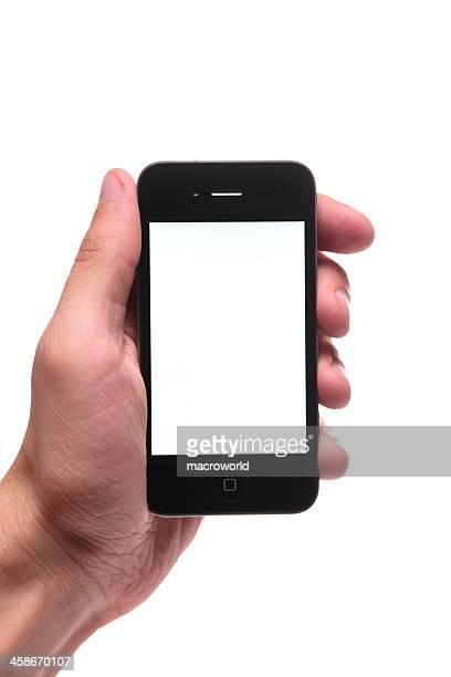 iphone 4. generation in der hand - ganzkörper freisteller editorial stock-fotos und bilder