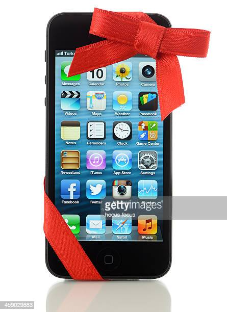 iphone 5 with red ribbon - gift icon stock photos and pictures