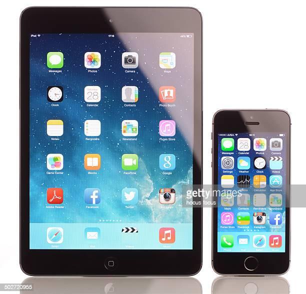iPhone 5s and iPad Mini on white background