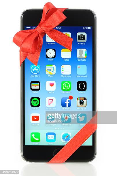 iphone 6 plus with red ribbon - gift icon stock photos and pictures