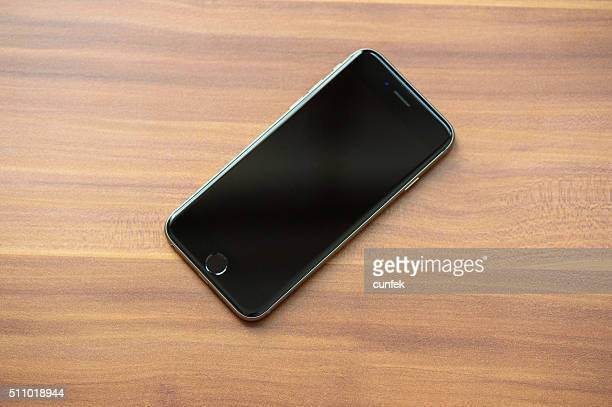 iphone 6s space gray on the table - off stock pictures, royalty-free photos & images