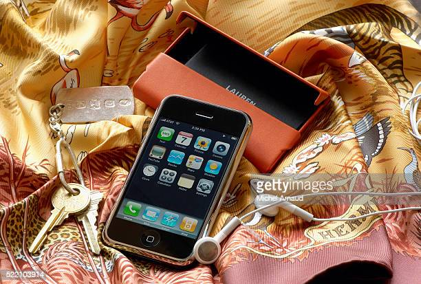 iphone and other status symbols - apple computers stock pictures, royalty-free photos & images