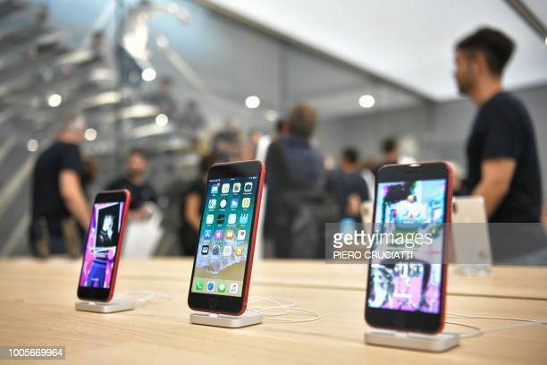 Iphones are on display at a new Apple Store Liberty the first Italian flagship store of Apple in Milan on July 26 2018