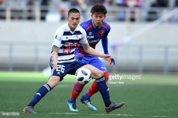 Ippei Shinozuka of Yokohama FMarinos and Kosuke Ota of FC Tokyo compete for the ball during the preseason friendly match between FC Tokyo and...