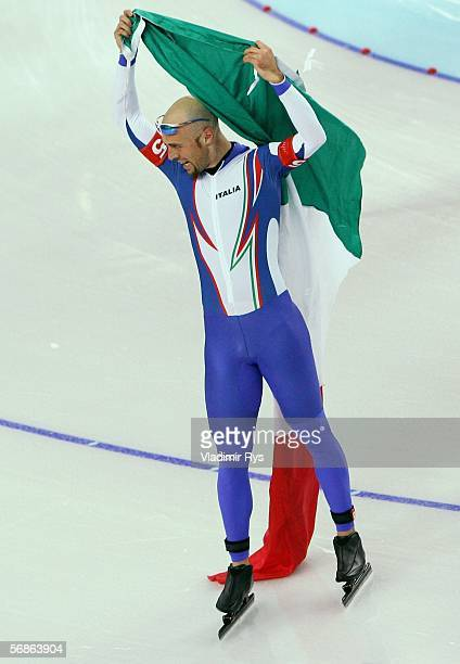 Ippolito Sanfratello of Italy celebrates defeating Canada with a time of 34446 to win the gold medal in the speed skating team pursuit during Day 6...