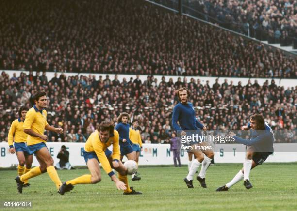 Ipswich defender Allan Hunter evades a shot from Chelsea player Steve Kember as Colin Viljoen looks on during a First Divsion match at Stamford...
