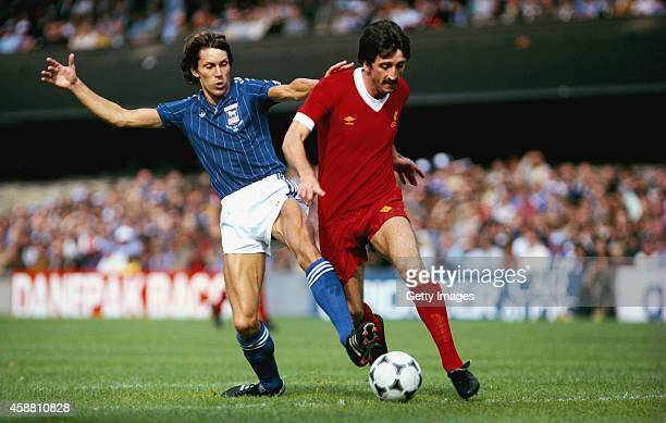 Ipswich player Arnold Muhren challenges Liverpool striker David Johnson during a League Division One match between Ipswich Town and Liverpool at...