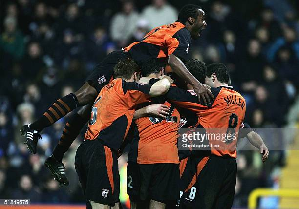 Ipswich players mob Darren Currie after he scores their third goal during the CocaCola Championship match between Queens Park Rangers and Ipswich...