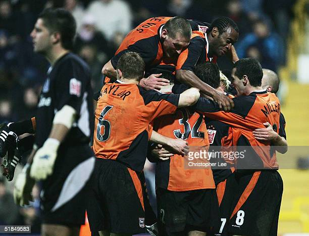 Ipswich players mobbed new boy Darren Currie after he scores their third goal during the CocaCola Championship match between Queens Park Rangers and...