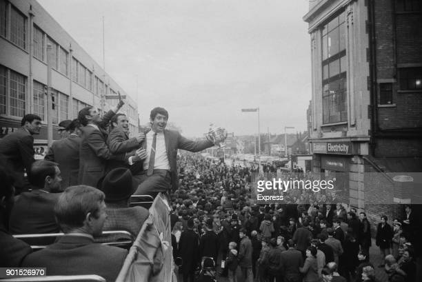 Ipswich Town FC soccer players drive through the town with the Second Division Cup Ipswich UK 22nd May 1968 British manager Bill McGarry guided...