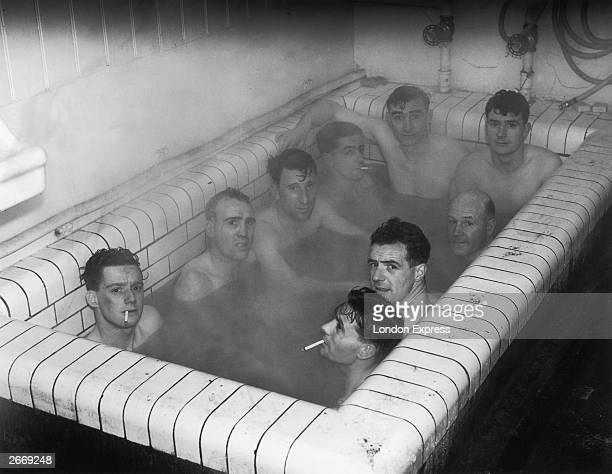 Ipswich Town football players having a bath together at Portman Road after the replay of their third round FA Cup match with Aston Villa 11th January...