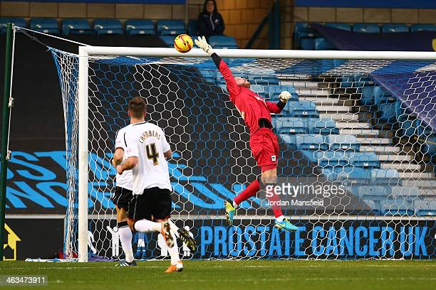 Ipswich Town goalkeeper Dean Gerken is lobbed by a goal from Ryan Fredericks of Millwall FC during the Sky Bet Championship match between Millwall...