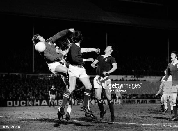 Ipswich Town goalkeeper Laurie Sivell fails to punch the ball under pressure from Allan Clarke of Leeds United as John Wark of Ipswich Town looks on...