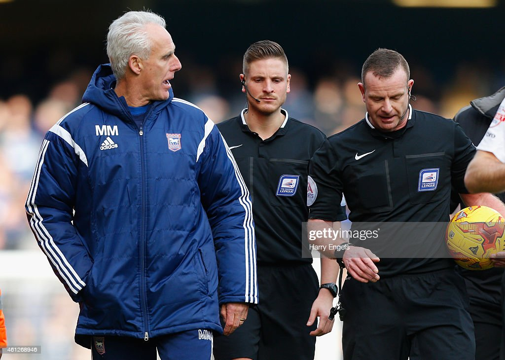 Ipswich Town manager Mick McCarthy (L) has words with referee Kevin Wright (R) at half time during the Sky Bet Championship match between Ipswich Town and Derby County at Portman Road on January 10, 2015 in Ipswich, England.