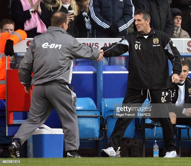 Ipswich Town manager Owen Coyle shakes hands with Ipswich Town manager Jim Magilton