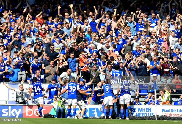 Ipswich Town players and fans celebrate as Gwion Edwards of Ipswich Town scores their first goal during the Sky Bet Championship match between...