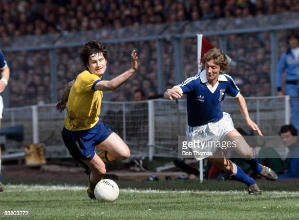 Ipswich Town winger Clive Woods takes on Arsenal captain Pat Rice during the FA Cup Final at Wembley Stadium 6th May 1978 Ipswich Town won 10