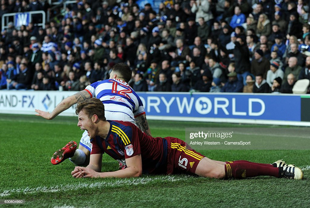 Ipswich Town's Adam Webster is fouled by Queens Park Rangers' Jamie Mackie during the Sky Bet Championship match between Queens Park Rangers and Ipswich Town at Loftus Road on January 2, 2017 in London, England.