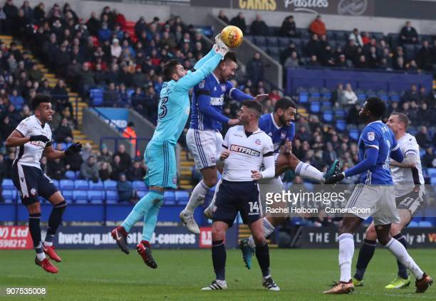 Ipswich Town's Bartosz Bialkowski makes a save under pressure from Bolton Wanderers' Gary Madine during the Sky Bet Championship match between Bolton...