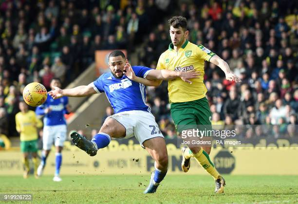 Ipswich Town's Cameron CarterVickers and Norwich City's Nelson Oliveira battle for the ball during the Sky Bet Championship match at Carrow Road...