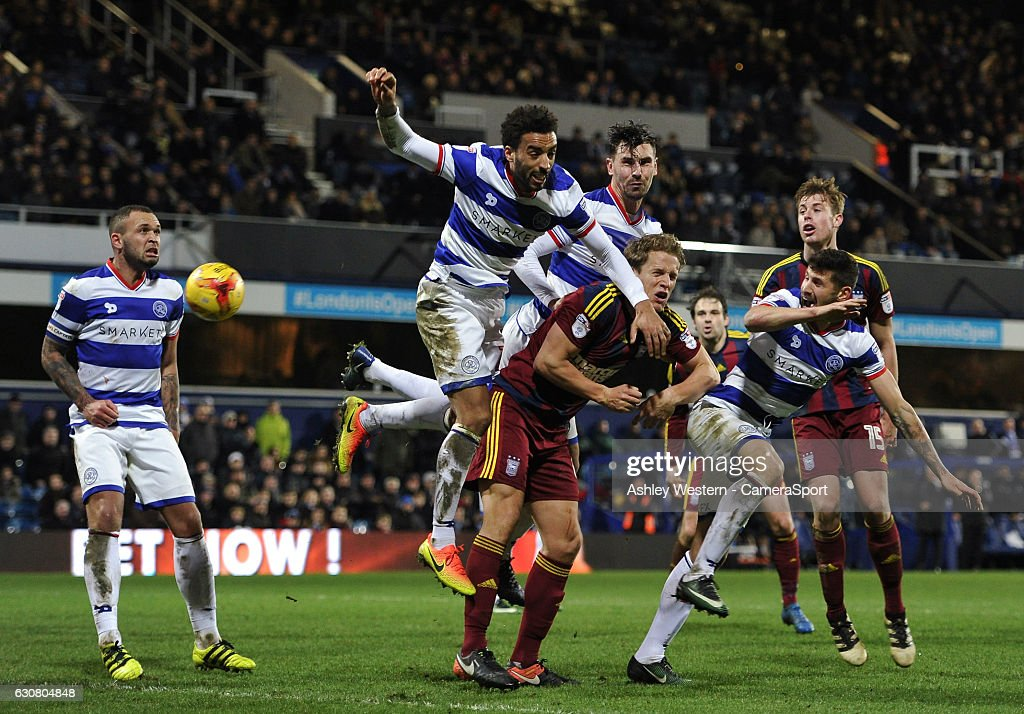 Ipswich Town's Christophe Berra battles with Queens Park Rangers' James Perch during the Sky Bet Championship match between Queens Park Rangers and Ipswich Town at Loftus Road on January 2, 2017 in London, England.